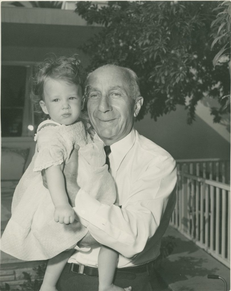 Harry Warner holding baby Cass Warner